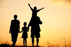 Silhouette, happy children with mother and father Royalty Free Stock Photos