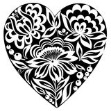 Silhouette heart and flowers on it. Black-and-white image. Old style Royalty Free Stock Photo