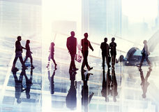 Silhouettes of Business People Walking inside the Office Royalty Free Stock Photography