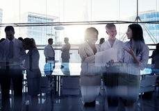 Silhouettes Of Multi-Ethnic Group Of Business People Working Tog Stock Images
