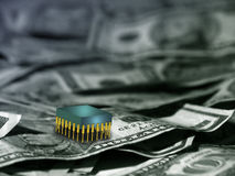 Silicon chip on pile of money Royalty Free Stock Photo