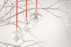 Silver Ornaments on Crystal Branches Stock Photo