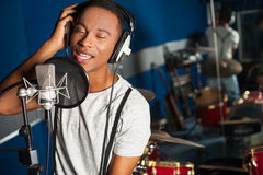 Singer recording a track in studio Royalty Free Stock Photos