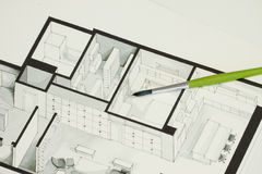 Single green brush set on real estate floor plan architectural isometric sketch sending a message for cold but elegant simplicity Stock Image