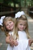 Sisters hugging Stock Photos