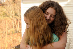 Sisters hugging Stock Photography