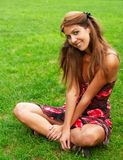 Sitting on grass Royalty Free Stock Photography