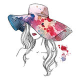 Sketch of a girl in a hat. Fashion illustration. Hand drawn Royalty Free Stock Photo