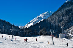 Ski run with people Royalty Free Stock Photo