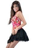 Skinny girl in a short skirt Royalty Free Stock Photos