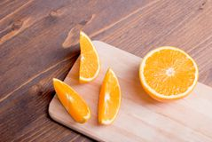 Sliced ripe appetizing delicious orange brown table Royalty Free Stock Images