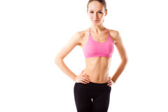 Slim waist of young sporty woman, detail of perfect fit female body isolated Royalty Free Stock Image