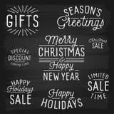 Slogans tirés par la main de lettrage pendant Noël et la nouvelle année Photo stock