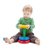 Small baby with a toy pyramid Stock Images