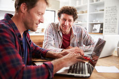 Small business partners using computers at home Stock Images