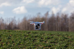 Small drone above the field Royalty Free Stock Photography