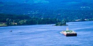 Small tug pushing huge barge Columbia River scenic Columbia Gorg Stock Photography