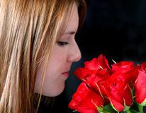 Smelling the roses Stock Photography