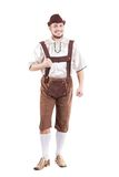 Smiling bavarian man in shirt and leather pants Stock Image