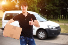 Smiling delivery man Stock Image