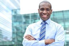 Smiling male executive outdoor Royalty Free Stock Photos