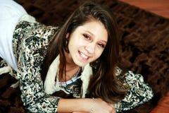 Smiling teenager on sofa Stock Photos