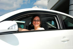 Smiling woman in modern car Stock Photo