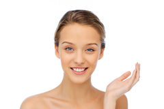 Smiling young woman face and shoulders Royalty Free Stock Image