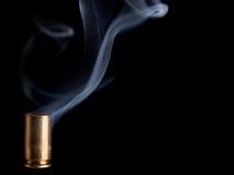 Smoking bullet casing Royalty Free Stock Photo