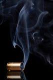Smoking bullet casing Royalty Free Stock Images