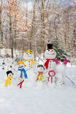 Snowman family Stock Images