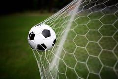 Soccer ball in goal Stock Images