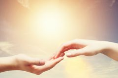 Soft, gentle touch of man and woman against sunny sky Stock Photo