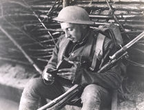 Soldier reading a book Stock Image
