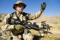 Soldier Signaling During Battle Stock Images
