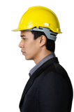 A solemn young foreman on the side view isolated Royalty Free Stock Image