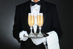 Sommelier with Champagne Glasses on Tray Royalty Free Stock Photography