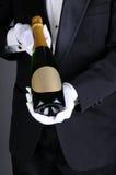 Sommelier Presenting Champagne Bottle Stock Photos