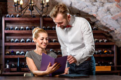Sommelier with young woman on degustation in the Stock Photography
