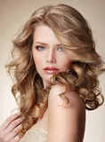 Sophisticated Woman with Perfect Skin and Flowing Blond Healthy Hair Royalty Free Stock Images