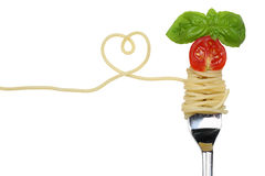 Spaghetti noodles pasta meal with heart on a fork love topic Stock Photos