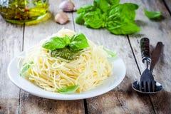 Spaghetti with pesto sauce and basil Royalty Free Stock Image