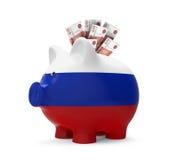 Sparschwein mit russischem Rubel Stockfotografie