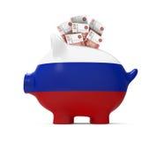 Sparschwein mit russischem Rubel Stockfotos