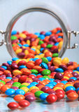Spilling rainbow sweets Stock Photo