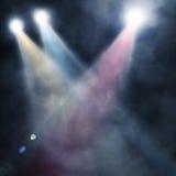 Spotlight  blue on smog background Stock Photo