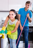 Spouses doing  regular cleanup and polishing Royalty Free Stock Image