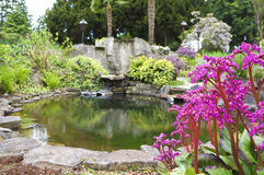 Spring American Northwest home water pond with landscape garden Stock Photos