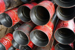 Stack of oil well intemediate casing bundles Stock Image