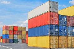 Stacked cargo containers in storage area of freight sea port ter Royalty Free Stock Photo